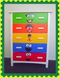 Each drawer has a different Sesame Street character. And it seems that Oscar the Grouch is on the top.