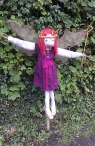 This one has a little purple dress and pink hair. But her crown and wand are twigs.