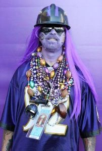 He also goes with beads, hard hat, and purple face paint for good measure. Let's hope he's not going to a Steelers game.