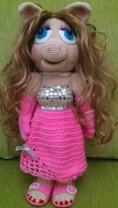 Like how they gave this one doll hair instead of yarn. The dress isn't too shabby either.