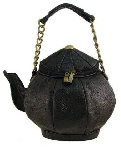 Because this is a teapot purse with the zipper and handle on the top. Hope the spout is well fastened.