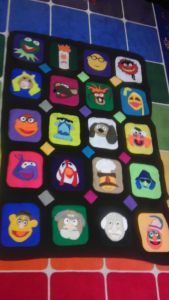 This shows many of your favorite Muppet characters in a square pattern. And the squares are all different colors. Like the rainbow tile background.