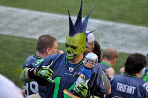 Don't mind that he has a skull face and a large blue mohawk. He's just really proud of his team.