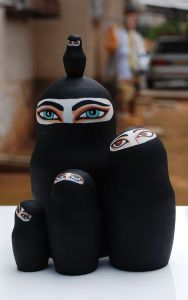 These are nesting dolls of Muslim women in the Middle East. Well, at least ones wearing a chador that only shows the eyes.