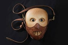 Hannibal Lecter on a purse? Seriously, this guy is a psychopathic killer who eats his victims. Having a purse of him is very messed up.