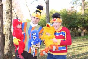 Parents are dressed up as Ernie and Bert. Dog is Cookie Monster. Kids are Elmo and Big Bird. The look on the dad's face is priceless.