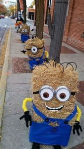 Yes, these the hay bales of minions from Despicable Me. There are a lot of minion scarecrows out there. This among the most creative.