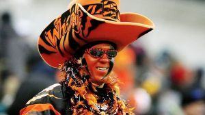 Doesn't hurt this person has the make up and accessories to match. Wouldn't want to sit near someone like that in the stands.