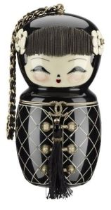 Looks a bit like a Russian nesting doll to me but the faces seem like you'd put on Japanese figures. Still, I think it's cute.