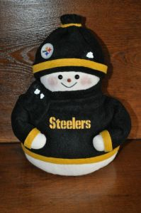 Yes, this little guy is made of cloth and donning the black and gold. So adorable.