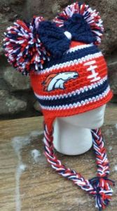 It's even shaped as a football as well as has a bow and pom poms. So cute.