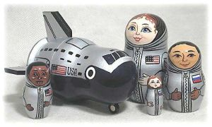 Yes, it's a crew of 4. But the largest doll is a shuttle. How cool is that?