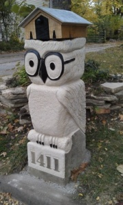 Well, the mailbox is on the owl statue. But it seems to be a quite clever design nonetheless. Love the owl glasses.