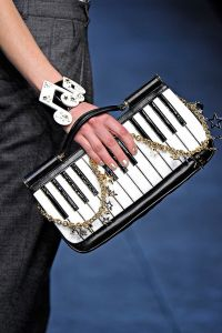 Well, it's a small piano keyboard. But since it's a purse, it may not be a great for doing scales.