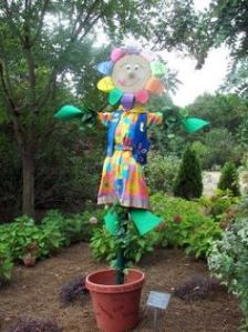 Helps that she seems to spring from a pot in a flowery dress. Love the rainbow petals.