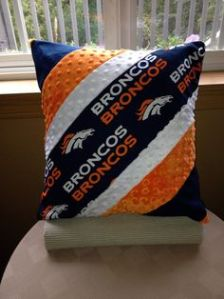This one uses Broncos, white, orange, and blue. Some of the material might be fuzzy according to the picture.