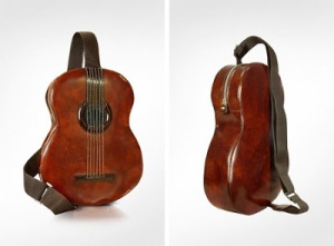 "From Crooked Brains: ""This guitar-shaped bag is made from premium vegetable-dyed calf leather and comes with an integrated mini speaker and outlet for you to connect your favorite MP3 player."" So I guess this is very expensive."