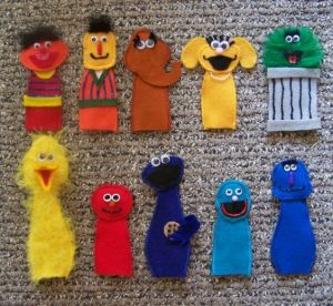 Includes, Ernie, Bert, Snuffy, Zoe, Oscar, Big Bird, Elmo, Cookie Monster, Grover, and Harry. Yet, each is adorable in its own way. Also, they forgot the Count.