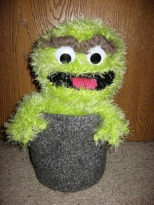 I also like the expression on his face, too. That's just so Oscar the Grouch. And he's proud of that. Now scram!