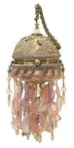 Not sure if it was called a jellyfish purse per se. But it certainly looks like one with the dome shape and the ribbons. Kind of quaint for a sea creature that kills more people than sharks.