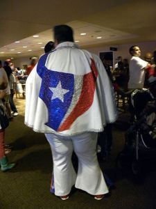 Yes, he has the Houston Texans logo on the back of his cape. And it's all sparkly, too.