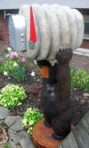 Didn't know you can have wood sculpture mailboxes. Not sure how that works. But this is quite clever.
