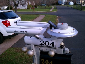Yes, this is a mailbox depicting the Enterprise from Star Trek which is set at a time when nobody uses mailboxes at all. Seriously, they have replicators and teleport technology.