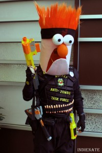For some reason, I don't normally see Beaker as a badass zombie hunter. But this is costume is clever and funny.