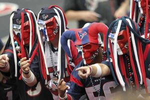 These Houston Texans fans wear skull masks and funny hats. But they take their team so seriously that you should be wary to laugh in front of them in their silly costumes.