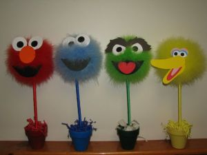 If you take off the character faces, they could be used for a Dr. Seuss themed occasion. Includes Elmo, Cookie Monster, Oscar, and Big Bird.
