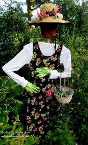 Sure her head is a flower pot and she wears a flower hat. But you have to admire how her bright green gloves would stand out. Also, that's not an outfit you wear for gardening.