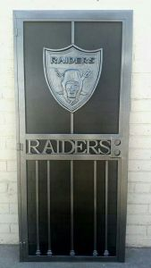 Really? An iron wrought door depicting the Oakland Raiders? Couldn't they just use the door that came with the house. Sure it's nothing fancy but at least they didn't have to pay a bunch of money on it.