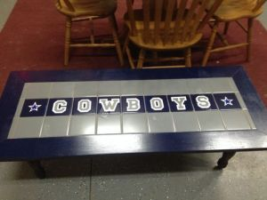 Yes, Dallas Cowboy fans' creativity should not be underestimated. Have to admire how this person used tiles on this wooden table. Lovely.