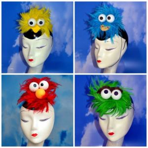 Includes Big Bird, Cookie Monster, Elmo, and Oscar the Grouch. And each one is made from fuzzy feathers.