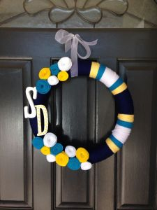"Yes, it might look like an ordinary wreath but it says ""SD"" and it's in Chargers colors. Love the flowers."