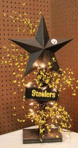 Even has yellow flowers to bring the gold in the black and gold. Love the black star and lights.