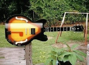 Yes, this mailbox is in the shape of an electric guitar. How cool is that?