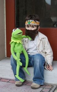 I think this is based on a photo of Jim Henson with Kermit in the 1970s. Still, love the little boy's beard.