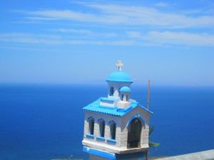 But you can't help but like this one of a dazzling blue church near a seaside town. So lovely.