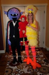 Like how the parents are Big Bird and Count von Count. And how the kid is Elmo. Wonder why the Count has a big head in this.
