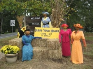 I think this was for a town scarecrow contest. But I love how these ladies are wearing bright colored dresses. And how one of them sits on the hay bale.