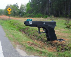 No wonder this mailbox belongs to an NRA member who doesn't believe in gun control. Probably a place I want to avoid.
