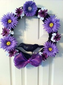 It even has a black bird in the center along with purple flowers. But it's a Ravens' wreath because of the logo on the top.