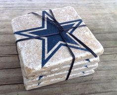 Each are made of some stone with the Dallas Cowboy star on them. And they're all tied in a ribbon when not in use.