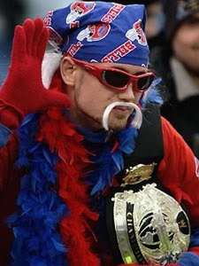 Actually this is a Buffalo Bills fan dressed as Hulk Hogan. But you have to admire his mustache and feather boas.