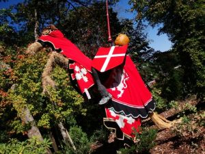 Yes, his horse might be made from a tree or straw. But he looks so cool in his red knightly attire.