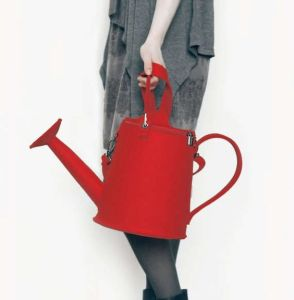 Yes, it's a watering can purse. No, it doesn't hold water since it's made from cloth. There's a difference.