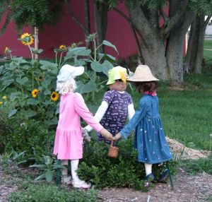 Well, I guess children scarecrows take up less straw. But you have to appreciate this concept. So cute.