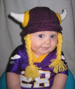 This little guy seems to look happy in this horned and braided cap. But watch the horns. So cute.