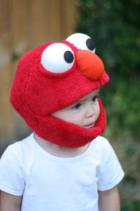 After all, Elmo's so adorable. Even has an opening to keep their chin warm. So cute.